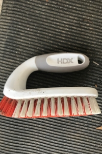 Scrub brush used here to prep for pressure washing DIY project for busy moms